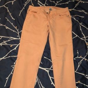 Light coral skinny jeans